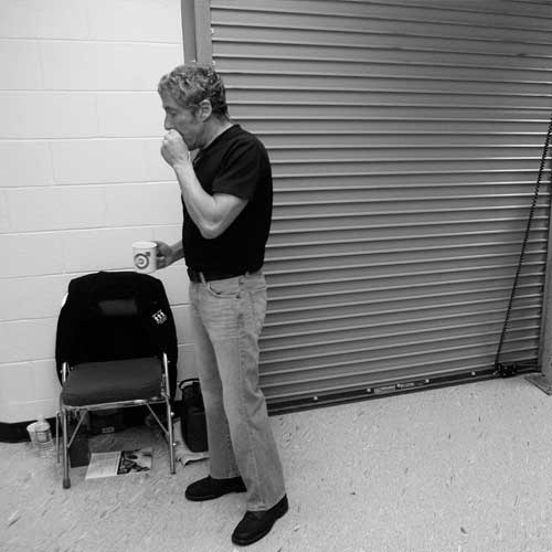 Roger Daltrey warms up on the harmonica backstage at The Arena at Gwinnett Center in Duluth, GA before The Who's performance on November 22, 2006.