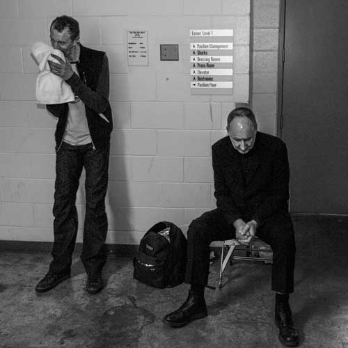 Pino Palladino and Pete Townshend take a breather before the encore to The Who show at HP Pavilion in San Jose, CA on November 8, 2006.