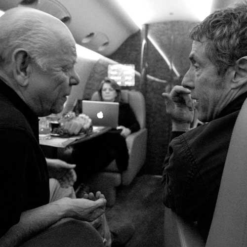 Stage sound engineer Bobby Pridden and Roger Daltrey chat aboard The Who's jet on November 19, 2006 following a show in Houston, TX.